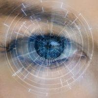 Diagrama blanco sobre ojo azul y gris